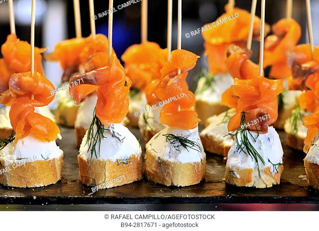 'Pintxos' of cheese and salmon. Sant Josep aka la Boqueria market. Barcelona, Catalonia, Spain