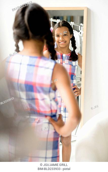 Reflection of Mixed Race girl in mirror