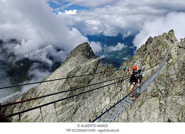 Italy, Retiche Alps, Lagoscuro Mountain Chain, Rope Bridge the Via Ferrata Sentiero dei Fiori