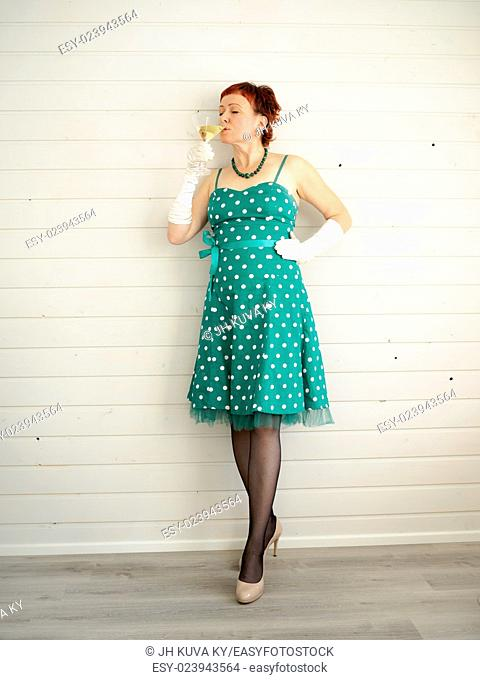 Attractive adult woman and champagne glass, 50s style