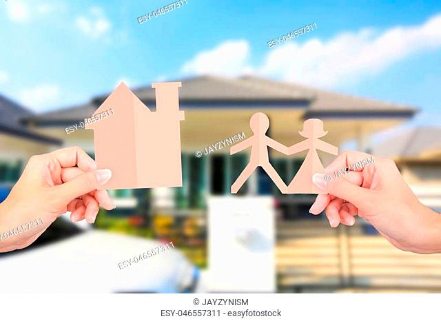 Hands holding family papers on home background