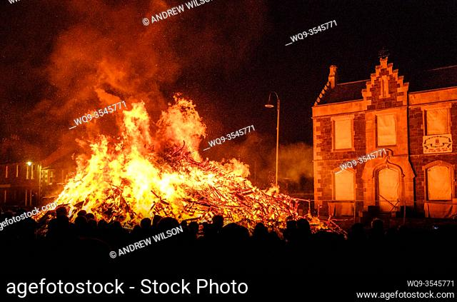 A large local crowd at the hogmanay bonfire, lit on 31st December each year to celebrate the new year in the Scottish town of Biggar