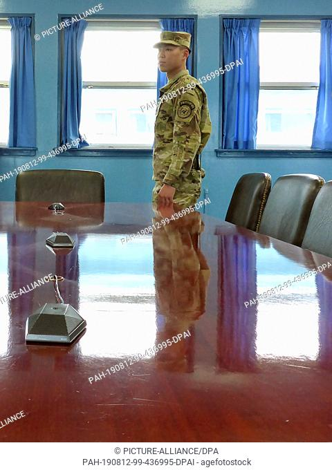 15 May 2019, South Korea, Paju: A US soldier stands at the desk in the blue barrack of Panmunjom in the Demilitarized Zone (DMZ)