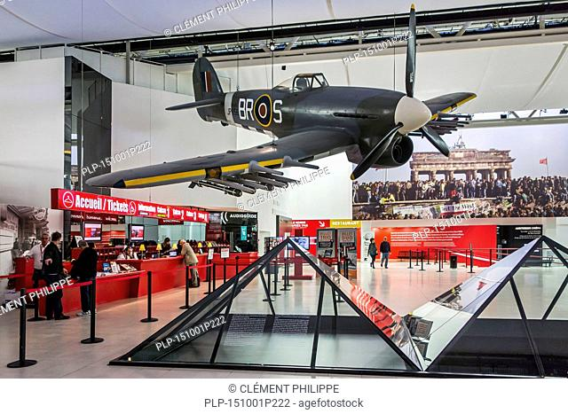 British World War Two Spitfire in the lobby of the Mémorial de Caen, museum and war memorial in Caen, Normandy, France