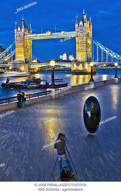 Photographing with tripod, Egg shaped sculpture, on background Tower Bridge, Riverside Southwark, River Thames, London, England, UK, United Kingdom, Europe