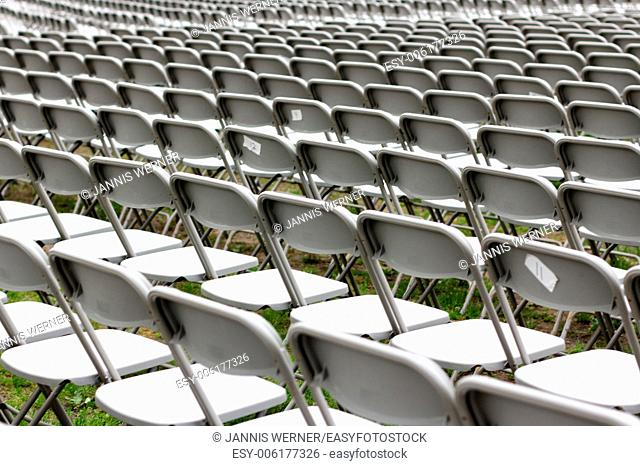 Row upon row of empty chairs waiting for the audience at a university graduation ceremony