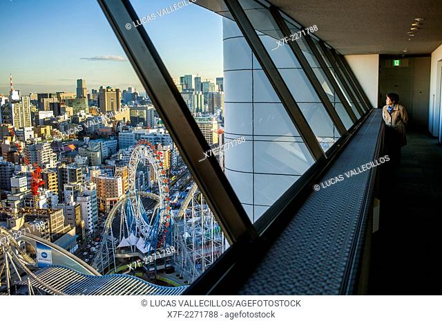 View of Bunkyo zone from a skyscraper, down Tokyo Dome City amusement park, Tokyo, Japan