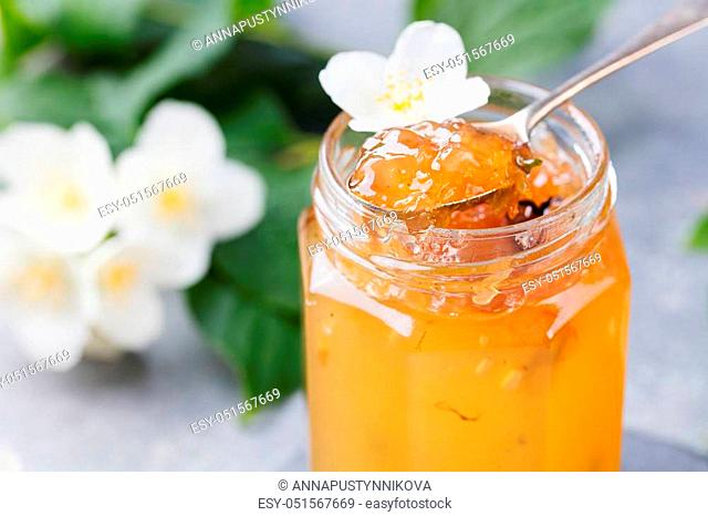 Jasmine flower confiture, jam with fresh jasmine flowers Grey stone slate background