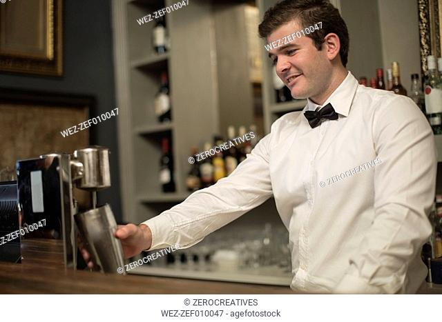 Barkeeper mixing a drink