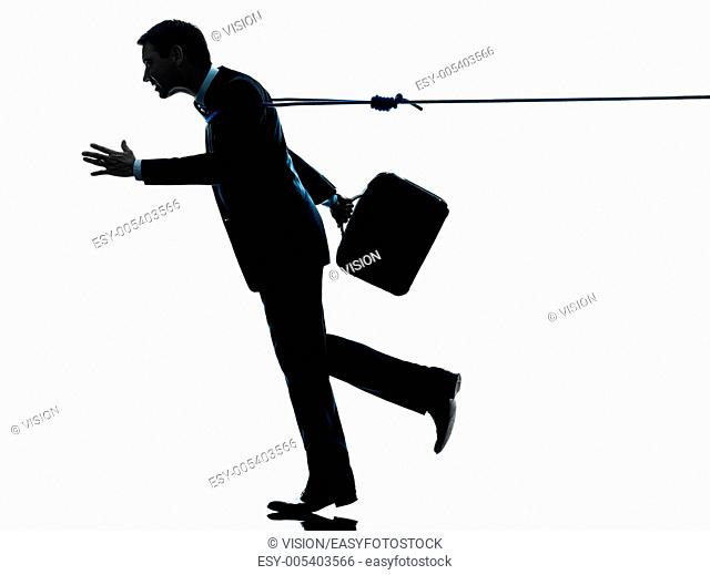 one caucasian business man catched by lasso rope in silhouette studio isolated on white background