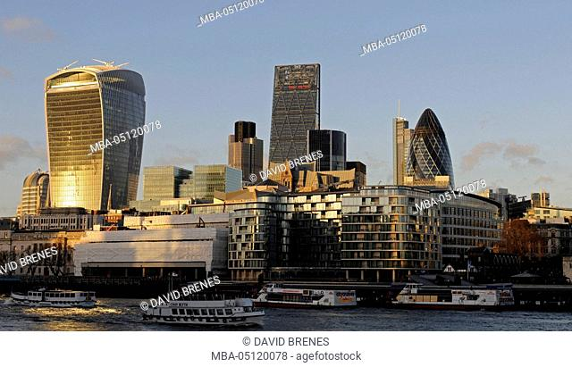 The Modern skyline of the City of London with The Walkie Talkie Building, The Gherkin, The Cheesegrater at sundown and the River Thames, London, England