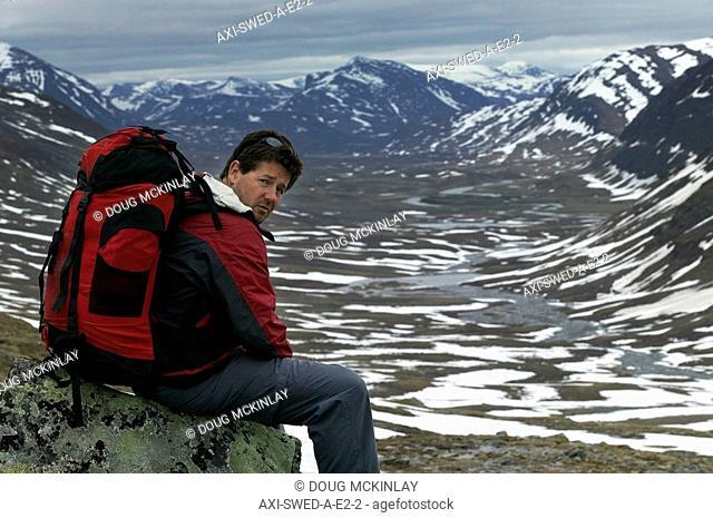 Male hiker sitting on rock on Kungsleden Trail,portrait, Abisko,Sweden