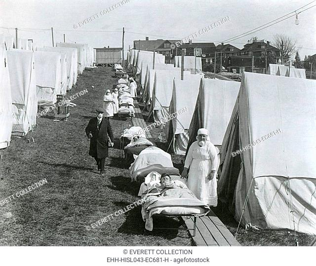 Spanish Flu Epidemic 1918-1919 in America. Emergency tent hospital, where doctors and nurses care for influenza cases. Brookline, Massachusetts, October 1918