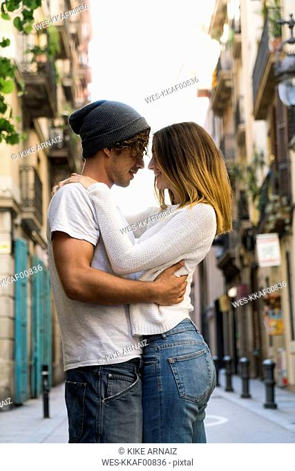 Young couple hugging in the city