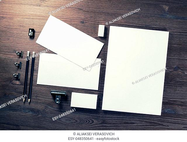 Blank business stationery set on wooden background. Corporate identity template. Branding mock-up. Flat lay
