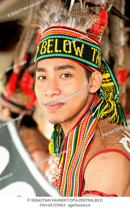 A man in a traditional costume during a welcome ceremony near Kota Kinabalu, Malaysia, on 30 October 2014. Photo: Sebastian Kahnert - NOWIRESERVICE- | usage...