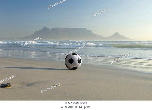 Africa, South Africa, Kapstadt, Soccer ball on beach