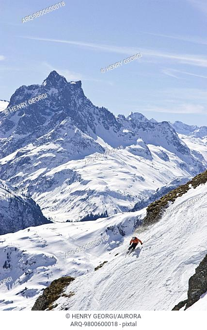 A young man skis down a steep slope at St. Anton am Arlberg, Austria