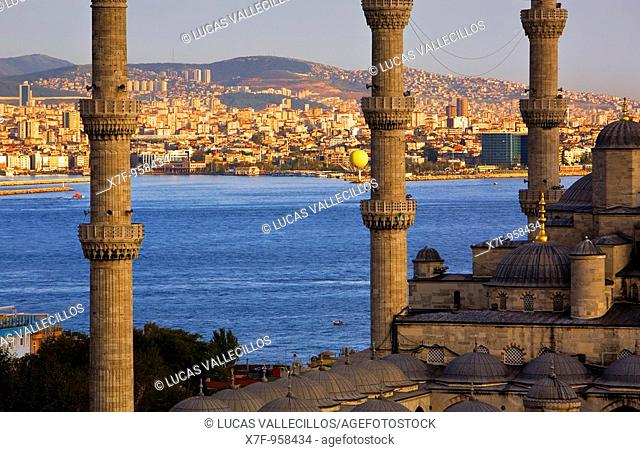 Minarets of Mosque Sultan Ahmet  Blue Mosque and Bosphorus strait, in background Asian side  Istanbul  Turkey