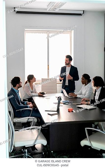 Young female and male business creative team at conference table presentation