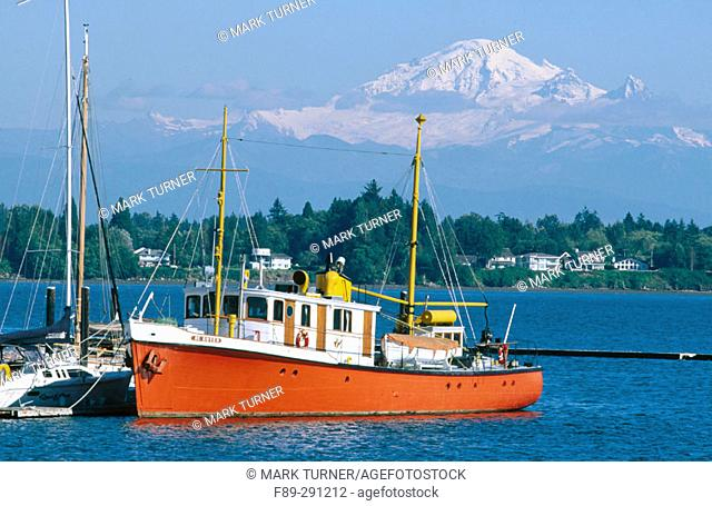 Boat at Semiahmoo Marina. Mount Baker in the background. Washington, USA