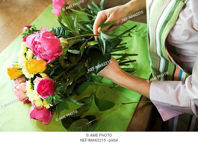 The hands of a woman working in a flower shop Sweden