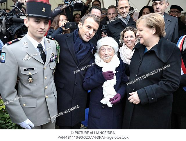 10 November 2018, France, Compiegne: German Chancellor Angela Merkel (CDU, r) and French President Emmanuel Macron (2nd from left) meet with representatives of...