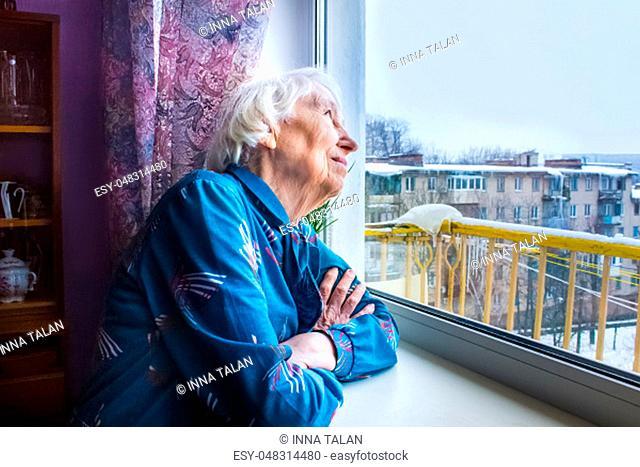 Senior woman at home reading book at home