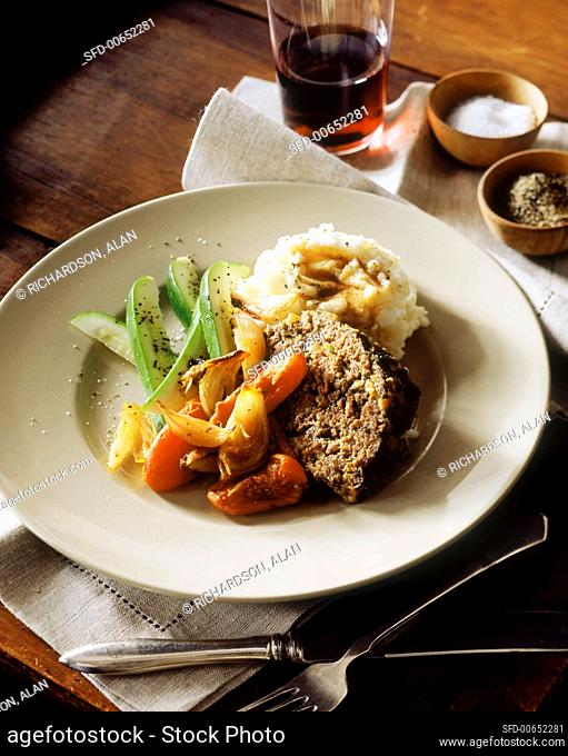 Meatloaf with mashed potato and vegetables