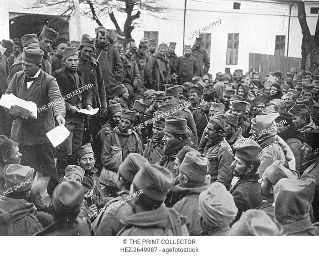 'Issuing passes for a few days leave at home to the wounded Serbian troops at Nish', 1915. Artist: Unknown