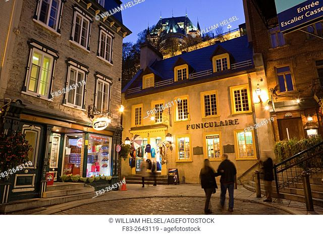 "Old Town Quebec City, """"Vieux-Quebec"""", Canada: Shops and entrance to cable car, """"Funiculaire"""", to upper town and Chateau Frontenac, dusk"