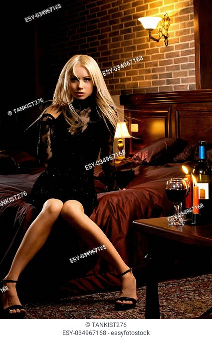 the very pretty woman indoor in interior bedroom, blonde