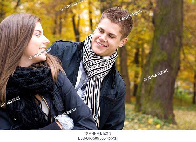 Young couple walking through the park Debica, Poland