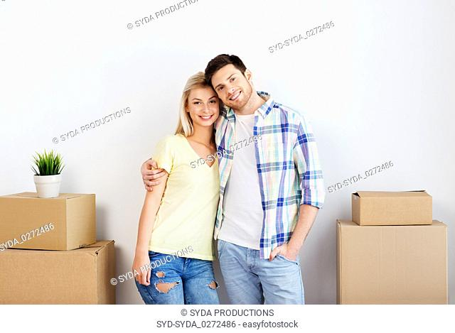 happy couple with boxes moving to new home