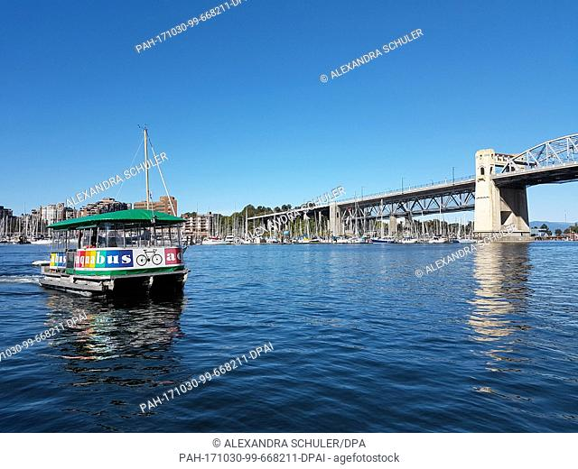 """A small ferry of the company """"""""Aquabus"""""""" can be seen at False Creek, near Granville Island in Vancouver, Canada, 27 August 2017"""