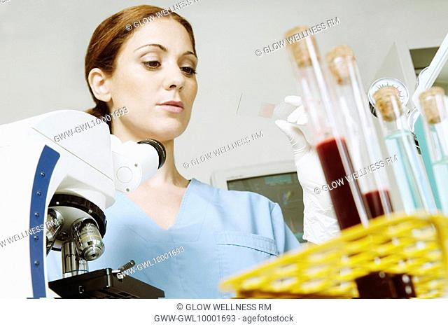 Female lab technician analyzing a sample in a laboratory