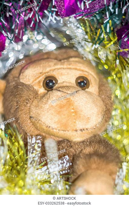 Brown monkey toy with decorated Christmas tree