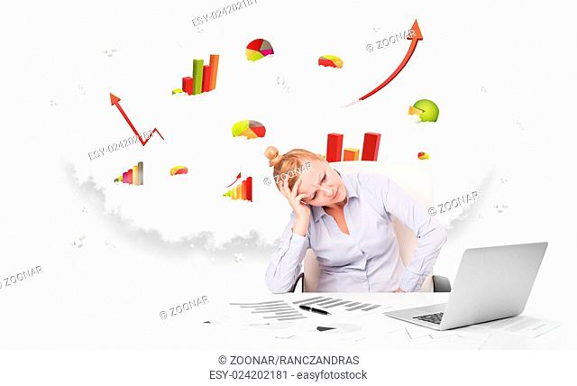 Young businesswoman with cloud in the background containing colorful graphs and diagrams