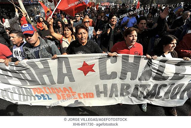 Santiago Chile May 01 2009 thousands of people demonstrate in the global day of the worker shouting slogans against the government of President Michelle...