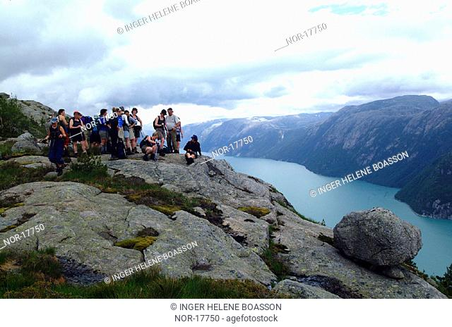 People admiring the view over Lysefjord