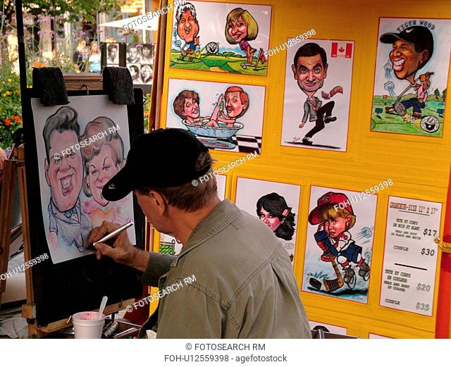 Montreal, Canada, QC, Quebec, Old Port, Old Montreal, Place Jacques Cartier, street artist sketching a caricature of a couple