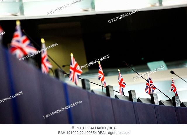 22 October 2019, France (France), Straßburg: Small flags of the United Kingdom stand on the tables of Members of the Brexit Party in the Chamber of Deputies of...