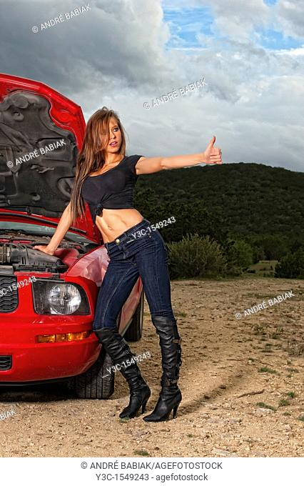 Sexy young woman with car trouble