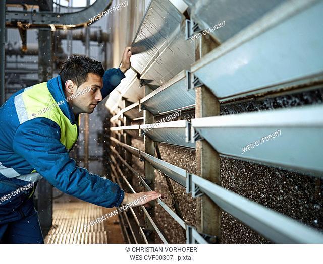 Rumania, Radauti, woodworking, worker checking cooling water of blast furnace