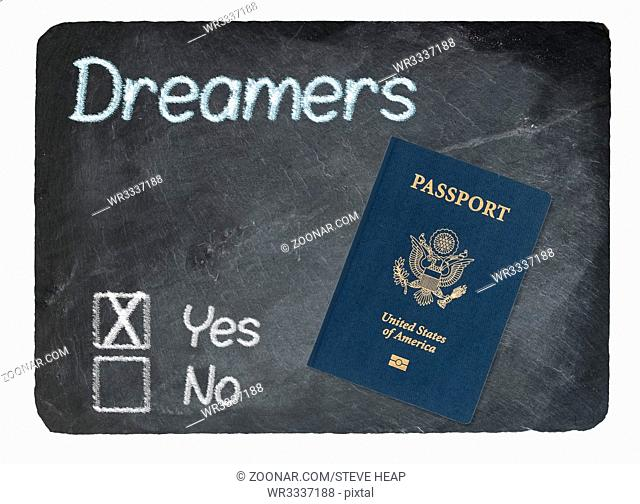 DACA Yes Vote message written in chalk on a chalky natural slate blackboard with Passport for Dreamers