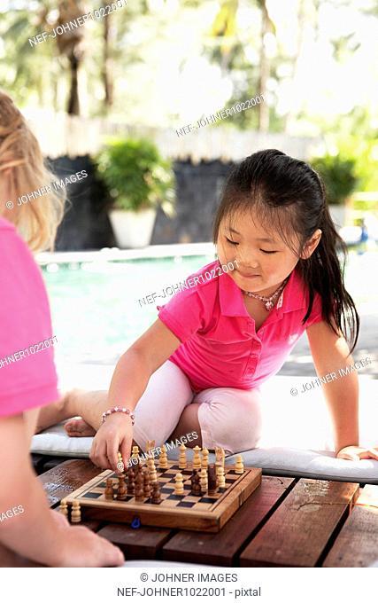 Thailand, children playing chess