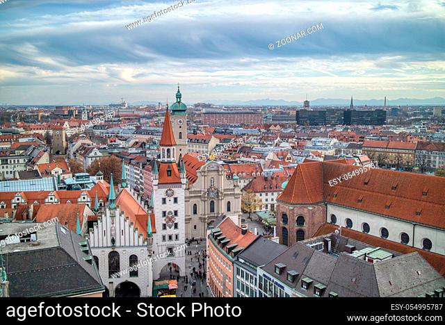 Urban landscape, aerial panoramic view above roofs of retro houses historical part of Munich, Germany on a background of cloudy sunset sky