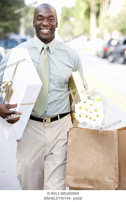 African man carrying gifts