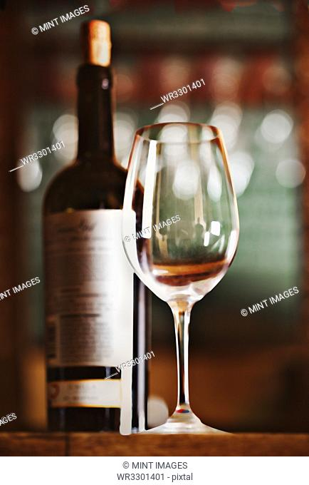 Close up of bottle of wine and glass