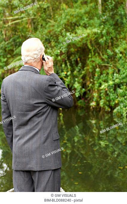 Hispanic businessman talking on cell phone